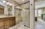 Stunning en suite with beautiful tile work and upgrades.