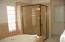 Private Commode Area, Linen Closet, Separate Shower & Soaking Tub