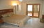 The Master Suite includes a FULL Bathroom & plenty of space for all your furniture. Notice the entry to the Art Studio.