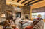 Family room; rock accented wall with warm wood beam ceilings