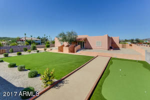 Beautifully manicured backyard with a putting green and room for playset, spa, and more!