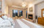 Master bedroom with exterior access, gas fireplace and sitting area.