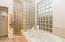 Master bath with glass block shower