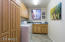 Laundry room with cabinets, sink and window so you can enjoy while doing laundry,..