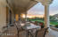Oversized flagstone covered patio around back perimeter of home...