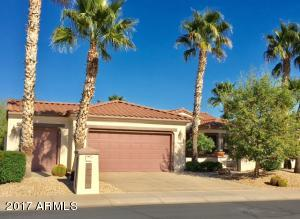TWO CAR PLUS GOLF CART GARAGE! BEAUTIFUL PALMS! TREE RIGHT OF DRIVEWAY HAS BEEN REMOVED.