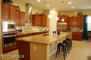 The Gourmet Kitchen is a focal point in this home. The 13 foot long island is spectacular!