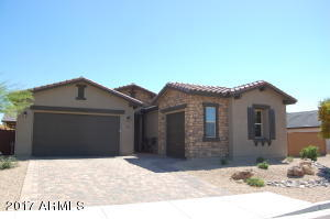 Great curb appeal! Stone accents on house, interesting roof lines, tumbled paver driveway.