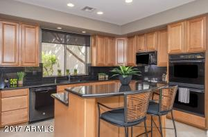 Ample storage, pantry, kitchen island and granite countertops