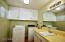 Large laundry room with sink and folding countertop.