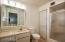 Master bath ensuite with walk-in shower and newer toilet.