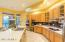 Spacious and functional kitchen with induction cook top and upgraded appliances throughout