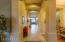 Impressive main hallway leads to Family Room beyond