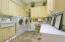 Laundry room is huge with wash sink and plenty of room for folding and storage