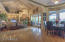 Towering ceilings highlight the family room with access to the patio