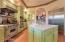 Subzero frig, center island, beautiful storage with glass panels and much more