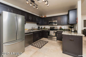 Totally updated kitchen with new cabinets, granite counters and stainless appliances.