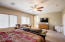 Master bedroom with abundance of windows and ceiling fan