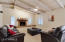 Family Room offers wood beamed ceiling and fireplace
