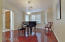 Formal Dining Room with hardwood floors and plantation shutters (currently used as piano room)