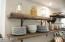 Beautiful rustic shelving in kitchen