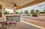 Covered patio overlooks HUGE lot with pool & RV parking.