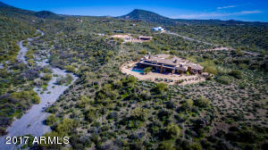 The panaramic vistas will awe you, at this gated estate. Untouched desert and cliffside living in a quiet and exclusive part of Carefree, with no HOA!