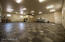 50' X 45' Hangar features 18 X 18 porcelain tiles throughout