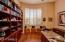 View of Den With Beautiful Hardwood Flooring