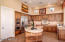 Custom Cabinets and Large Island Complete with Bookshelves On Both Ends and a Builtin Dacor Warming Drawer