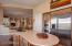 View Into Great Room From the Kitchen. Dacor and Kitchenaid Stainless Appliances.