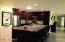 Space - beautiful cabinets - open to dining, living room & office.