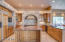 GOURMET KITCHEN WITH HUGE CENTER ISLAND, BREAKFAST BAR AND TONS OF CABINETS/DRAWERS WITH SPECIAL FEATURES!