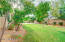 LOVELY GRASSY BACKYARD WITH SPORTS COURT! YOU COULD THROW A FOOTBALL OR PLAY SOCCER HERE!