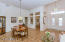 Double door entry, soaring ceilings, separate den/library