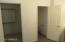 Closet has space for two with the water closet at the back of the bathroom.