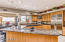 Large Gourmet Kitchen with Granite Counters and a 6 burner gas stove