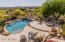 Imagine looking out from your upper patio to the pool/spa & the golf course. There is a misting system to keep you cool.