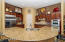 Stainless steel appliances. Double ovens and gas cooktop.