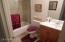 Tile and Glass Doors at Tub in Hall Bath