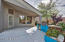 Covered Patio with lush landscaping and PVC watering system.