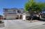 Three car garage and xeriscaping