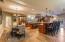 Spacious kitchen with room for a kitchen table and seating at the bar.