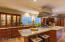 Custom cabinets with built-in china cabinet with display lighting.