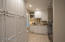 """This is a """"wow"""" laundry room. Loads of storage, counter space and recessed lights."""