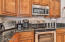upgraded kitchen cabinets, granite counters & stainless steele appliances