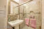 Hall Bathroom with walk-in shower.