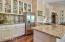 Mosaic Metallic Back Splash And Refinished Lower Cabinets.