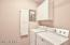 Washer / Dryer Convey. Cabinets And Pull Down Ironing Board Accent This Space.