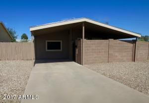 West facing house with large carport and private entrance.